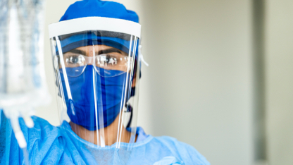 A medical professional in personal protective equipment