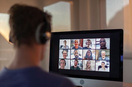 A person attending a video conference call on their computer